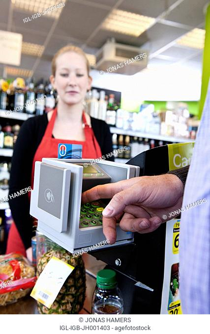 ATM machine and a Maestro credit card during a payment in a supermarket