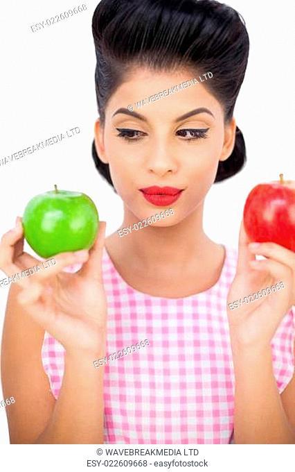 Thoughtful black hair model holding apples