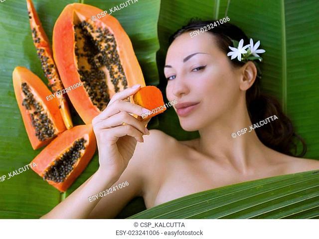 Happy Woman Eating A Papaya Stock Photos And Images Age