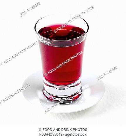 Glass of Grape Juice on a Saucer