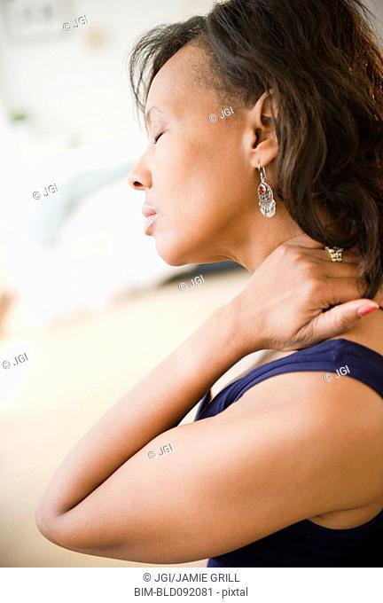 Black woman rubbing her neck