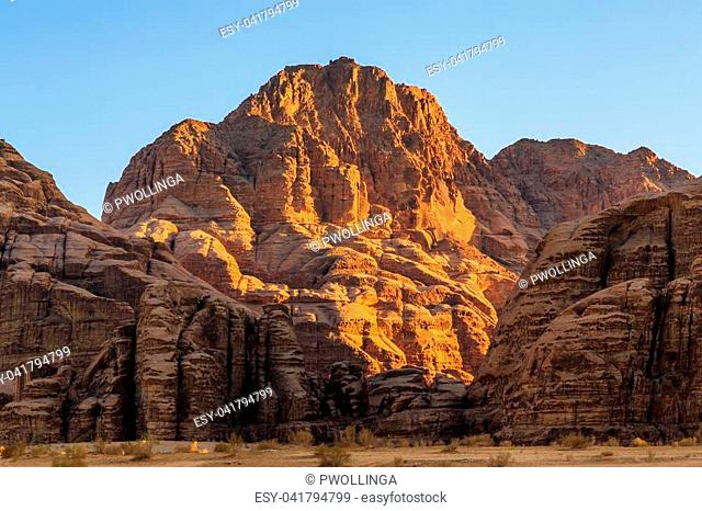View of the yellow colored mountain rocks in the Wadi rum desert in Jordan at early-morning sunrise