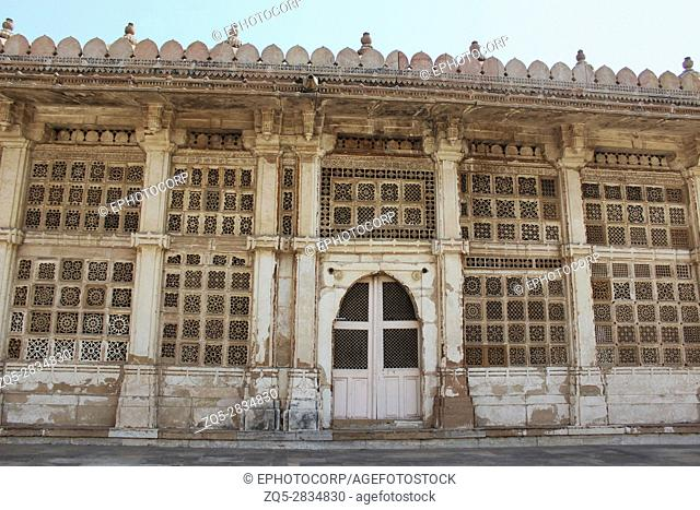 Carved stone grills on the walls of the Tomb of Sufi Saint Shaikh Ahmed Khattu at Sarkhej Roza in Ahmedabad