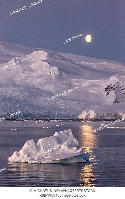 Moonrise over icebergs in the Gerlache Strait, Antarctica, Southern Ocean