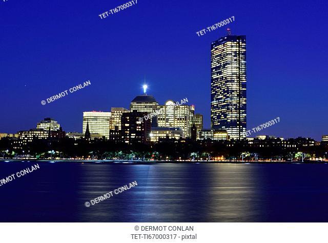 Illuminated waterfront buildings at dusk