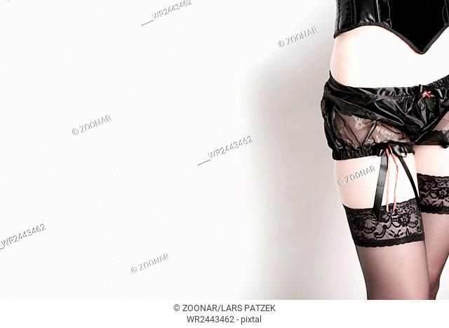 Young woman in panties and stockings