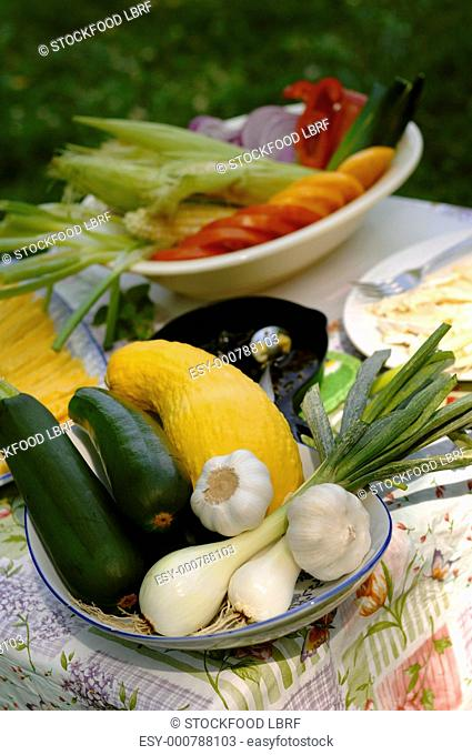 Dish of fresh vegetables on a garden table