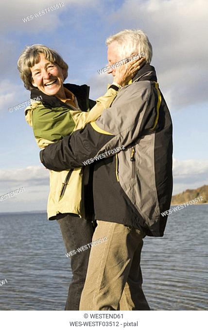Senior couple embracing, smiling