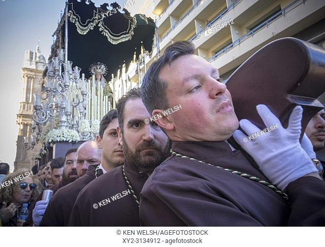 Malaga, Costa del Sol, Malaga Province, Andalusia, southern Spain. Semana Santa. Holy Week. Throne with the Virgin Mary being carried through the streets