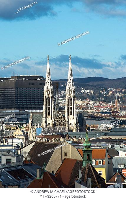 Vienna city skyline with the twin spires of the Votive Church seen from the top of St. Stephens Cathedral (Stephansdom) North tower. Austria