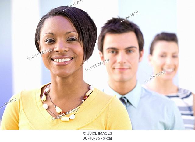 Businesswomen and man, smiling, portrait, close-up