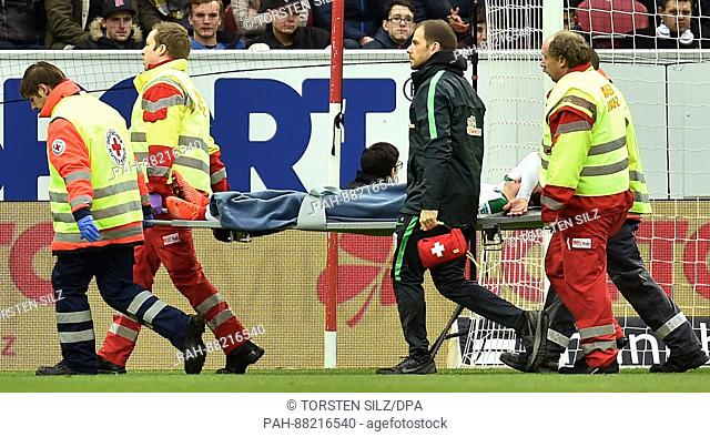 Bremen's Thomas Delaney is stretchered off the pitch after suffering an injury during the German Bundesliga soccer match between FSV Mainz and Werder Bremen in...