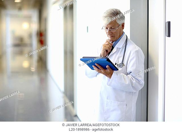 Doctor with tablet in corridor, Onkologikoa Hospital, Oncology Institute, Case Center for prevention, diagnosis and treatment of cancer, Donostia, San Sebastian