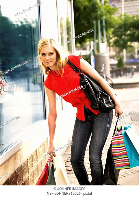 A young woman shopping