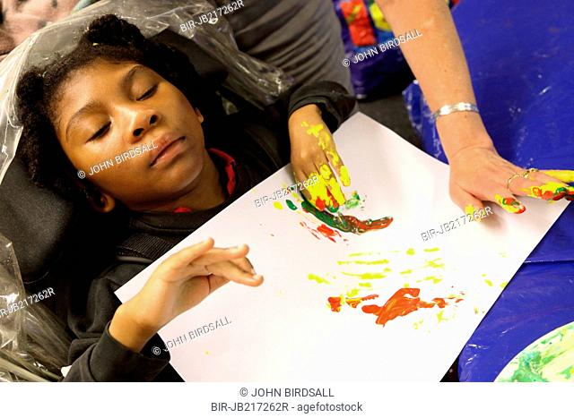 Girl doing painting at Mysight charity for people with visual impairments, Nottingham