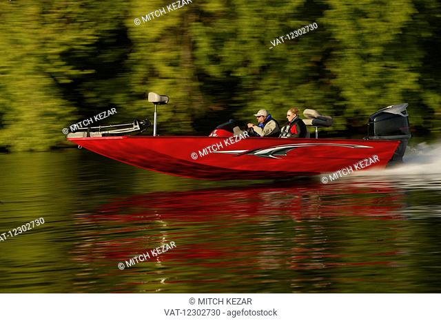 Red Speed Boat Running On Lake