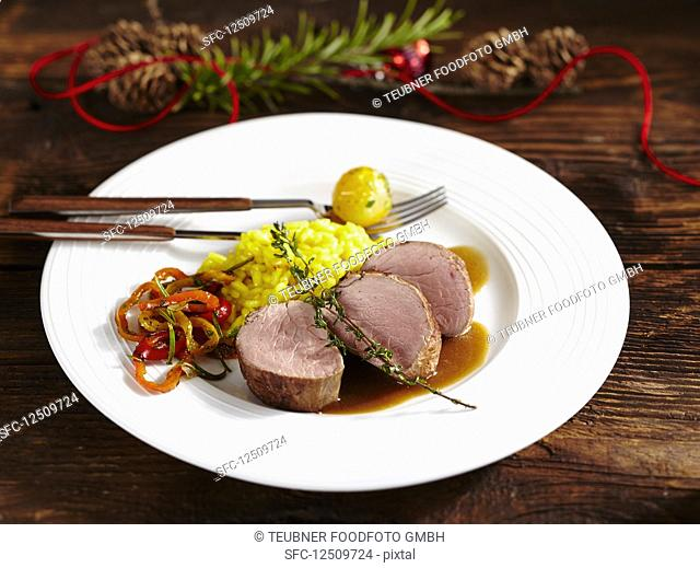 Pork fillet with saffron rice and vegetables