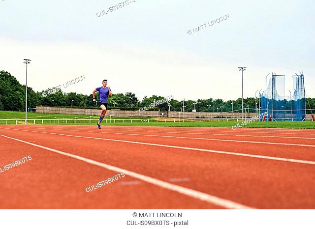 Runner training on running track