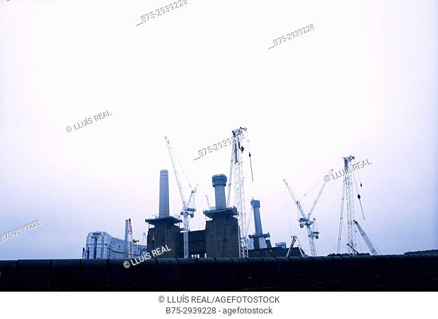 View of power station with cranes. Battersea Power Station, London, England