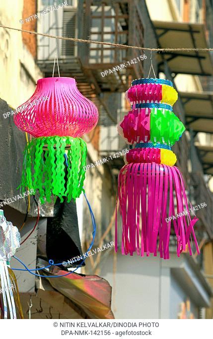 Colourful lanterns of plastic material for sell in shop ; Diwali deepawali Festival ;  Bombay now Mumbai ; Maharashtra ; India