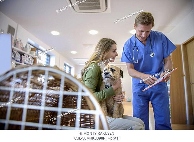 Veterinarian talking to dog owner