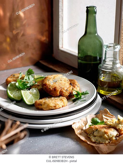 Crab cakes with lime slices on plate