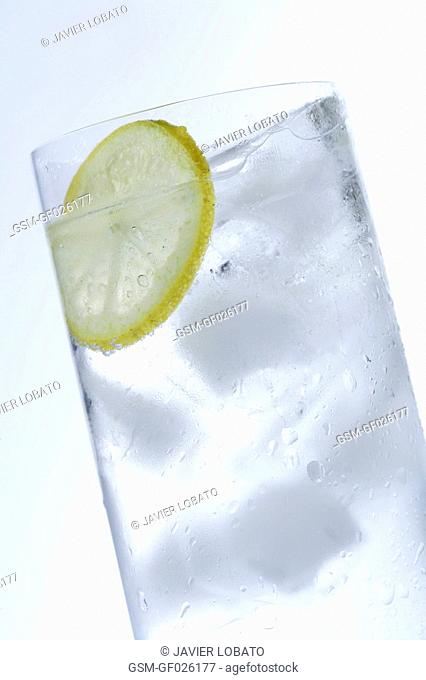 Tonic water in tall glass with lemon slice