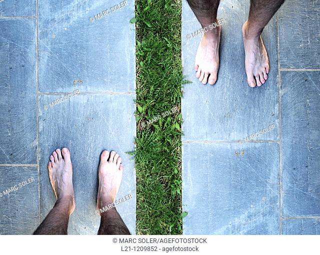 Man's bare feet on brick slate