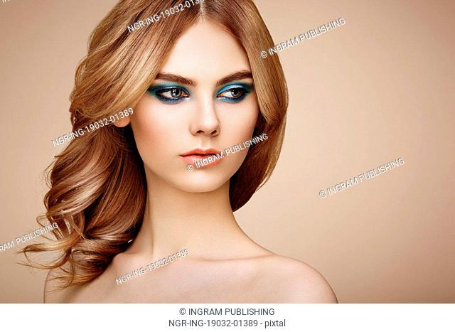 Portrait of beautiful sensual woman with elegant hairstyle. Perfect makeup. Beauty fashion. Eyelashes. Lips. Cosmetic Eyeshadow