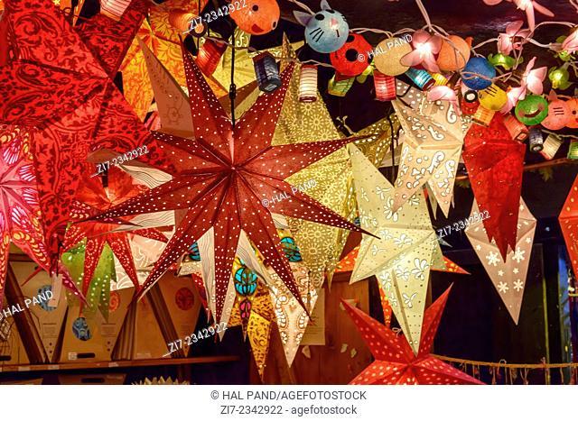 detail of lightened stars in stall at traditional Christmas market hold in city center, Stuttgart, Germany
