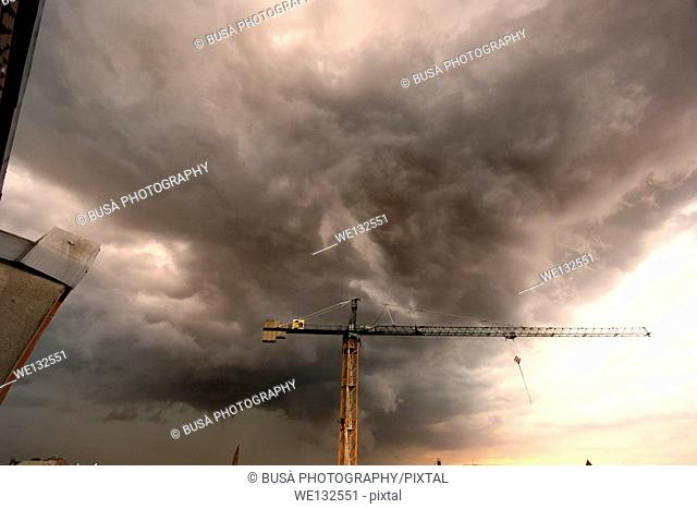 Summer Storm in the sky of Berlin, Construction crane in a storm