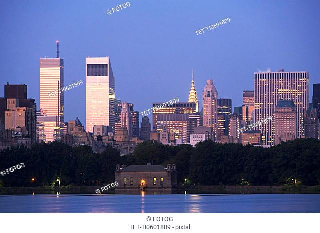 USA, New York State, New York City, Skyline with Bloomberg Building and Chrysler Building at dusk, view from Central Park