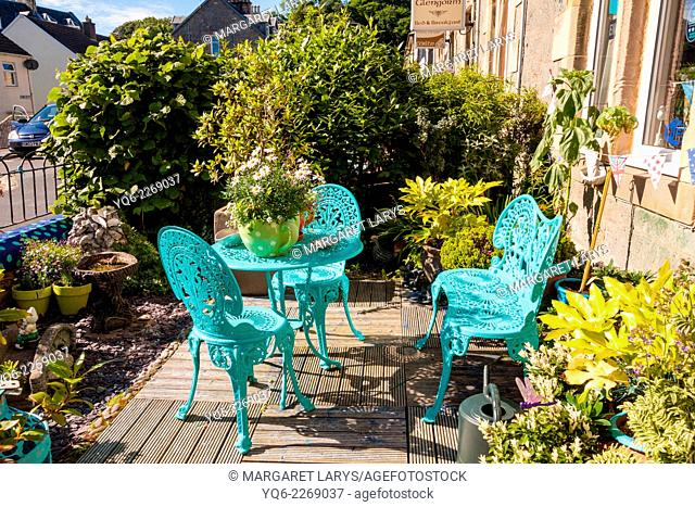 Summer Garden with stylish green table and chairs, Scotland