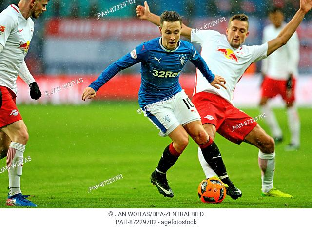 Glasgow's Barrie McKay (front) and Leipzig's Stefan Ilsanker in action during the soccer test match between RB Leipzig and Glasgow Rangers at the Red Bull Arena...