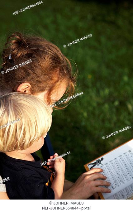 A woman and a child reading a book
