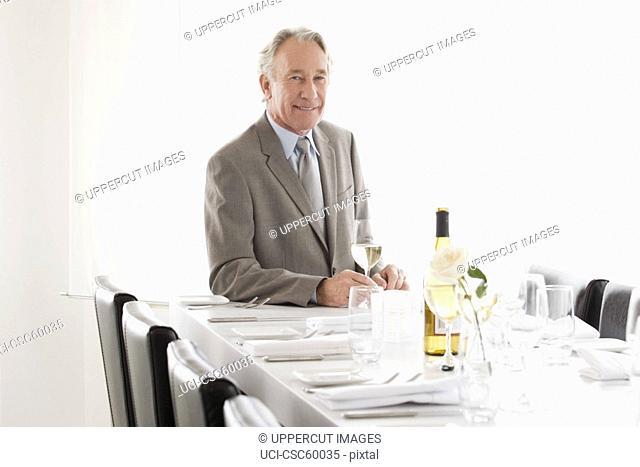 Senior businessman sitting at restaurant