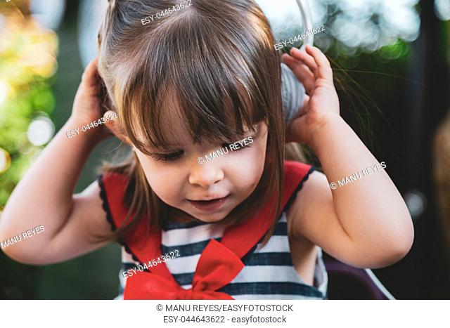 girl listening to music with headphones and smiling. Madrid, Spain