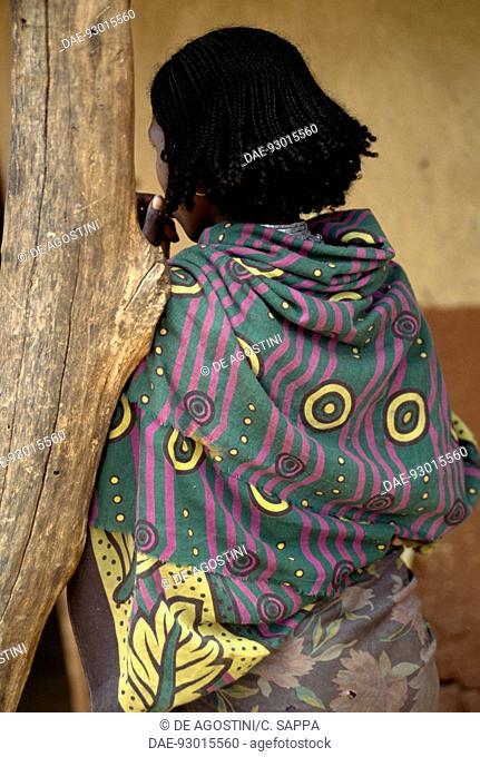 Young Borana woman in traditional dress seen from behind, Eliwaya, Yabelo, Ethiopia