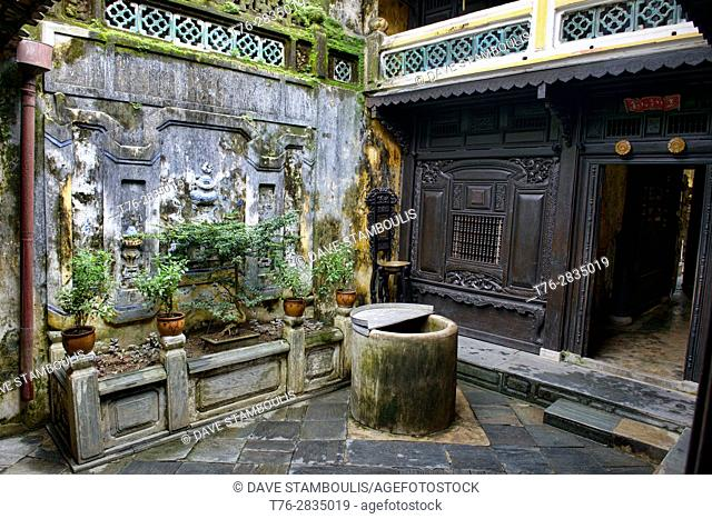 Courtyard and well in the Old House of Tan Ky, a heritage house in Hoi An, Vietnam
