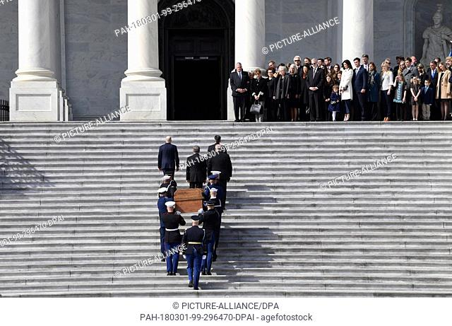 The family of Rev. Billy Graham watches as the casket of Rev. Billy Graham is carried up the steps of the U.S. Capitol in Washington, Wednesday, Feb