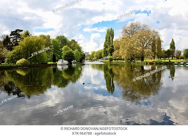 River Great Ouse with overhanging trees at Godmanchester with Blue Sky and Cloud Reflections