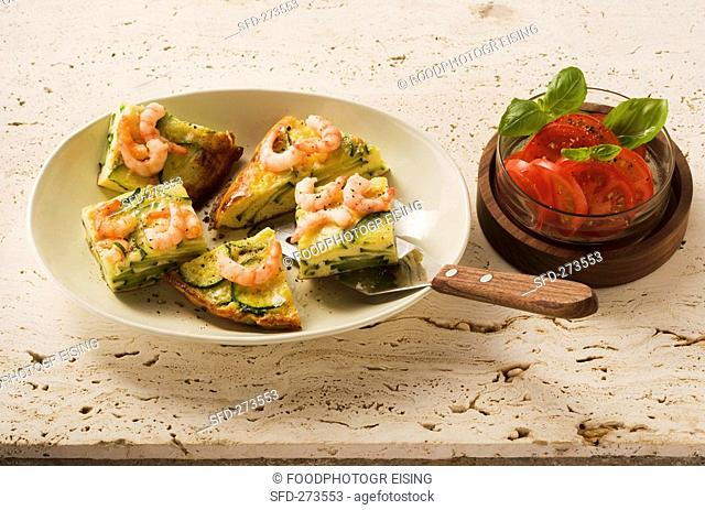 Courgette tortilla with prawns and tomato salad