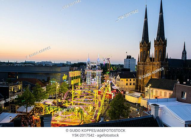 Tilburg, Netherlands. The annual carnival in front of the church seen from above at dusk