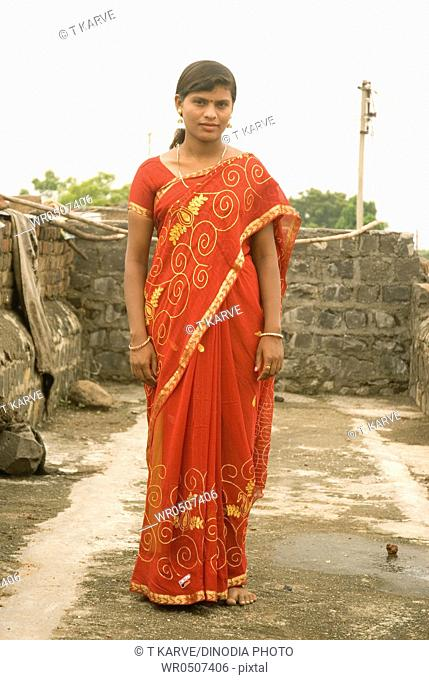 Girl in red sari , village Vaitagvadi , Parbhani , Maharashtra , India MR688