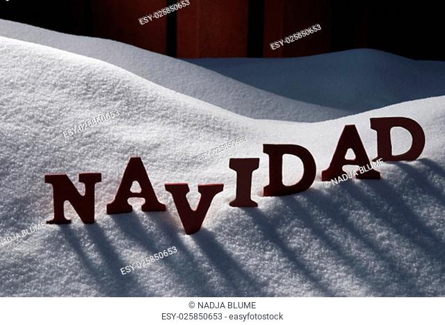 Red Letters On White Snow As Christmas Card. Spanish Word Navidad Means Christmas. Snowy Scenery And Atmosphere. Rustic Vintage Wooden Background