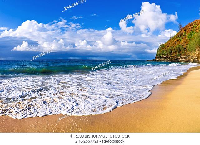 Sand and surf at Hanakapi'ai Beach along the Kalalau Trail, Na Pali Coast, Island of Kauai, Hawaii