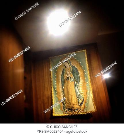 An image of Our Lady of Guadalupe decorates a house in Colonia Roma, Mexico City, Mexico