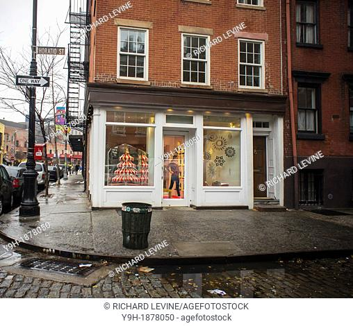 6bee31b59e88 The Christian Louboutin shoe store in the West Village neighborhood of New  York displays their Christmas