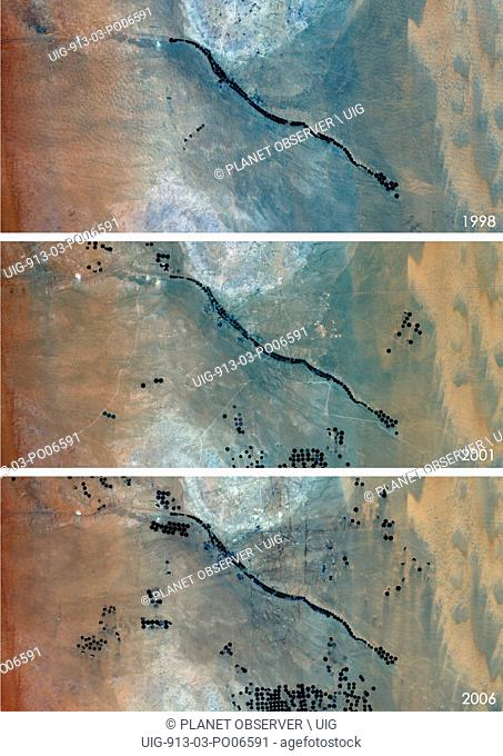 Satellite view of Agriculture in the Desert in Saudi Arabia in 1998, 2001 and 2006. This before and after image shows the expansion of circular agricultural...