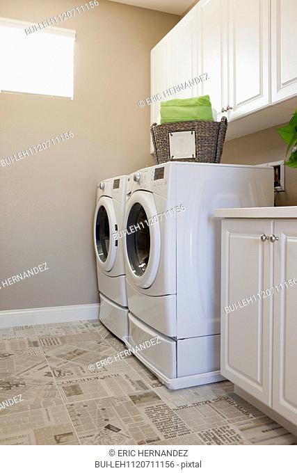 Washing machines in utility room; Azusa; California; USA